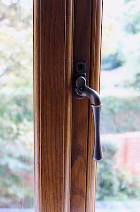 Flush casement window with black monkey tail handle
