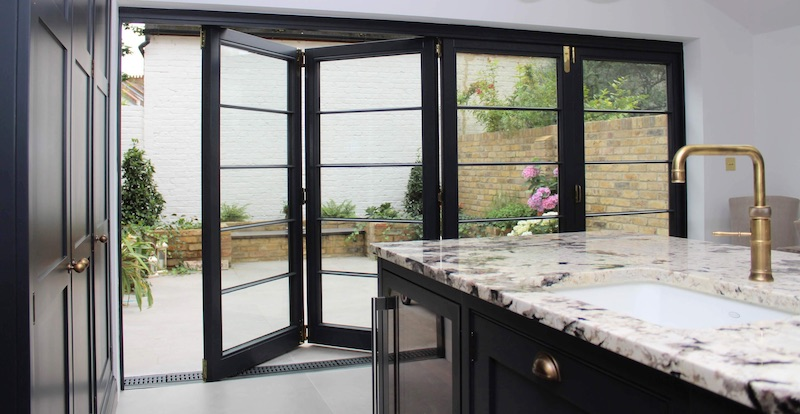 Crittall style timber Bi-folding doors with four doors in Clapham