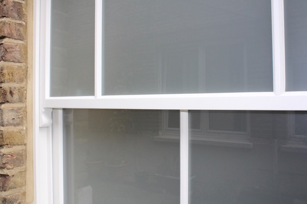 Frosted glass in a timber sash window