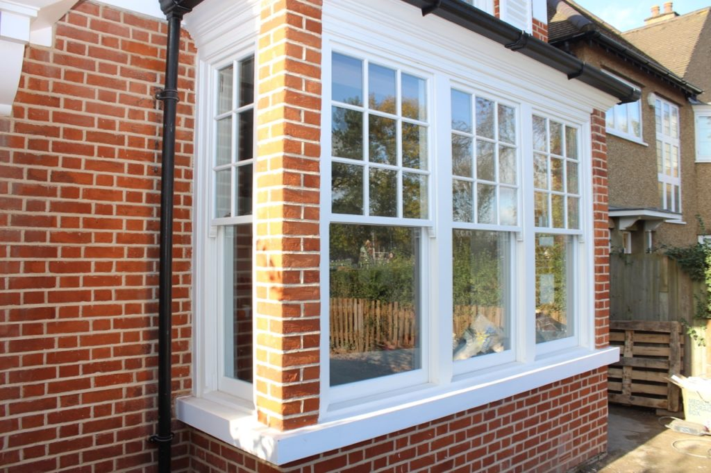 Square bay with 6 over 1 sash windows.