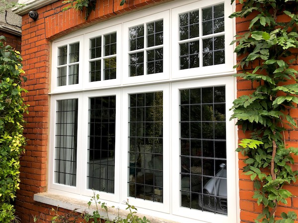 A large wood casement window in Queen's Park, North London