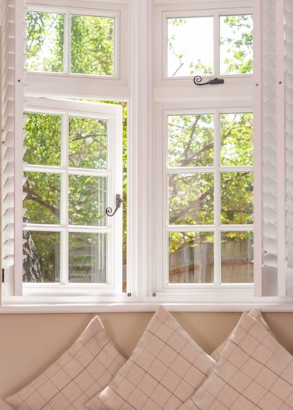 A flush casement window with shutters
