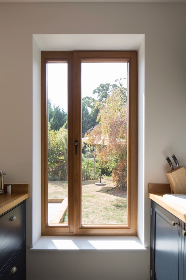 Tilt and turn hardwood casement windows
