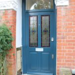 blue entrance door with decorate glass