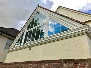 A flush casement window system build into a roof