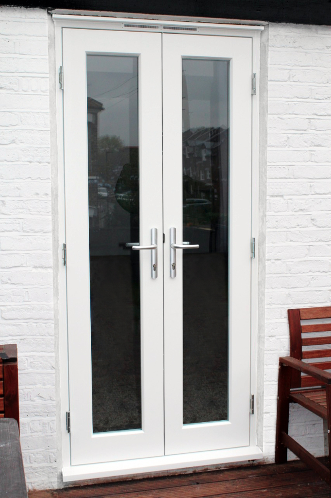 Wooden French Doors With A White Finish