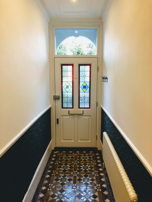 wooden front door with decorated glass view from inside