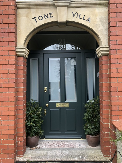 Bespoke timber entrance door with frosted glass in traditional building in London
