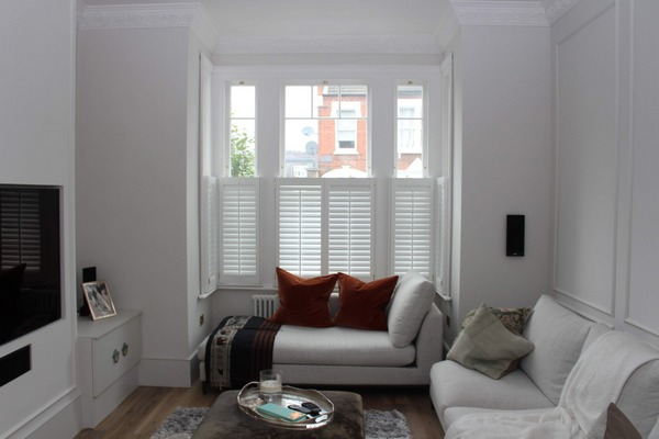 modern living room with large sash window in London property