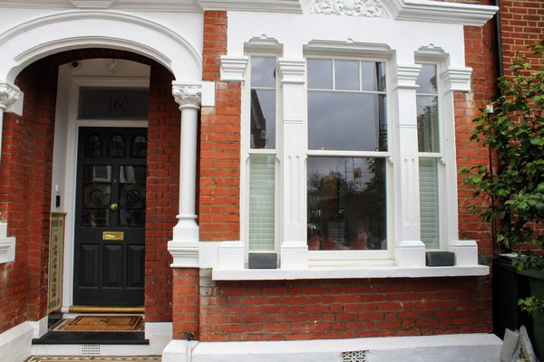outside view of a traditional wooden sash window and entrance door