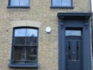 London Property with dark wood sash windows and door