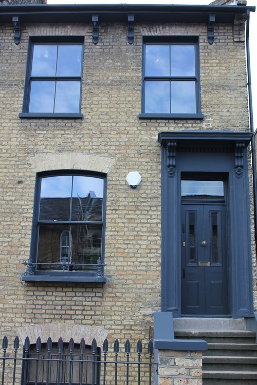 London Property with dark wood sash windows and door
